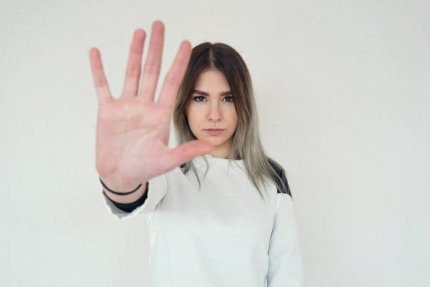 girl with hand out to say stop