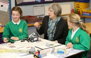 theresa may with school children