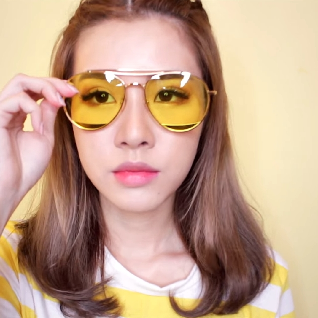 woman wearing tinted glasses