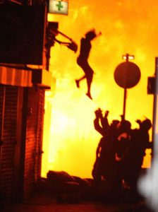 woman jumping from burning building